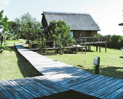 A wooden pathway leading to the resort unit.