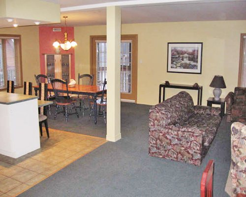 An open plan living and dining area with a breakfast bar.