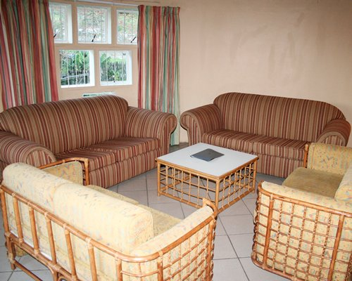 A well furnished living room with double pull out sofa and an outside view.