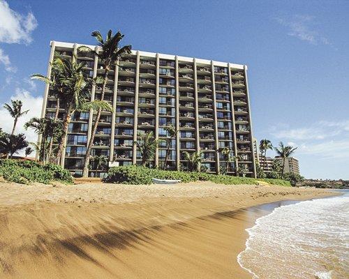 A beach view of the multi story WorldMark Valley Isle resort.