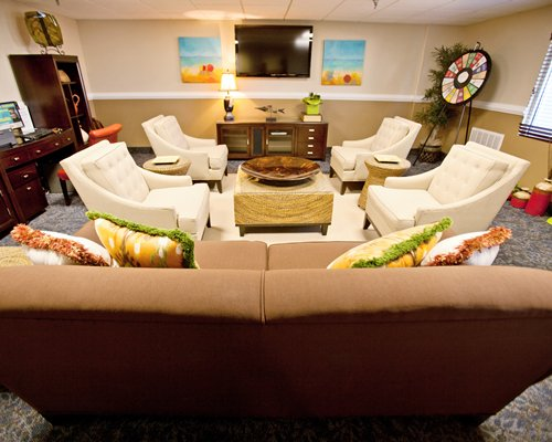 A well furnished living room with pull out sofas and television.