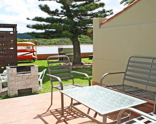 Patio with patio furniture alongside a waterfront.