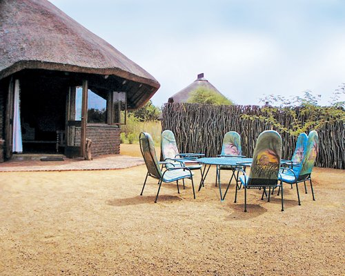 An exterior view of Sondela Nature Reserve resort unit with patio furniture.
