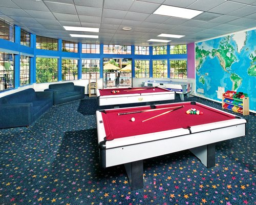 Indoor recreation room with pool tables.