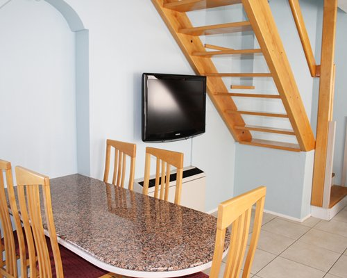 A dining area with television.
