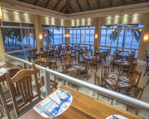 A well furnished indoor restaurant with the beach view.