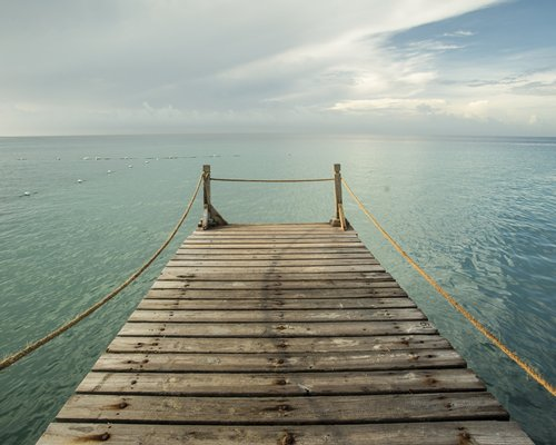 Wooden pier leading to the ocean.