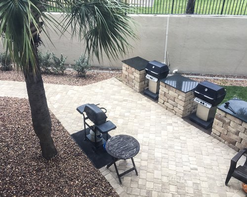 Outdoor picnic area with barbecue grills.