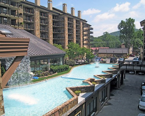 A view of water feature alongside the resort units and parking.