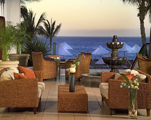 Resort lounge area with water fountain facing the ocean.