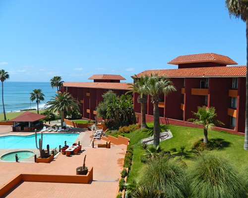 An exterior view of resort units alongside the ocean.