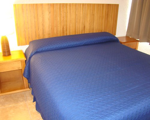 A furnished bedroom with a queen bed.