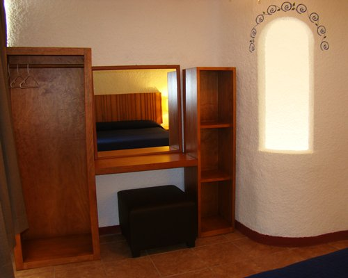 A well furnished room with a dresser.