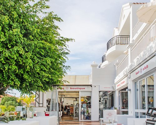 An exterior view of a boutique alongside trees.