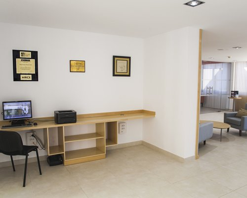 A common room with a computer and printer.