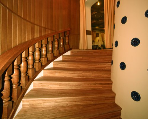 A wooden themed indoor staircase.