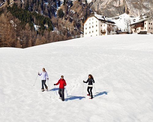 Three people skiing on the snow.
