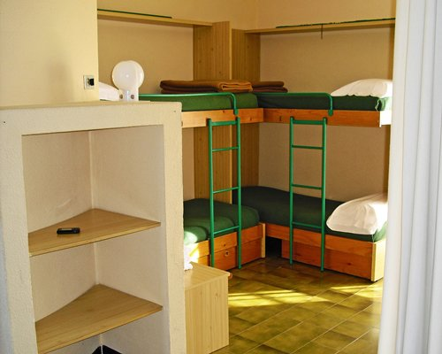 A furnished bedroom with bunk beds.