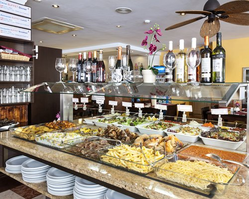 An indoor buffet area with various dishes and beverages.