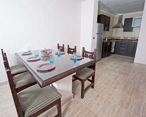 A well furnished dining room alongside the kitchen.