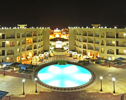 A night view of the multi story Mirette Touristic Village.
