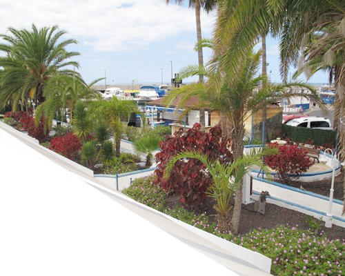 Exterior scenic landscape at Puerto Colon Club with parking lot.