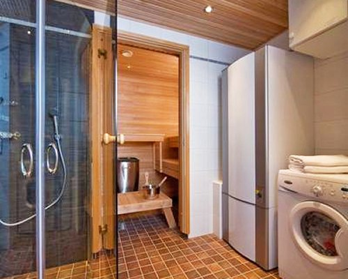 A bathroom with a shower stall and sauna.