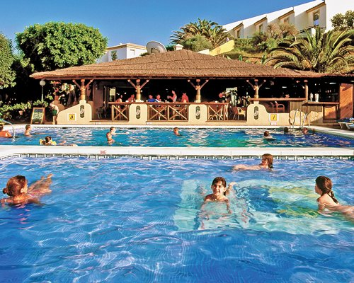 Two large outdoor swimming pools alongside the snack bar.