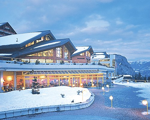 An exterior view of the Les Thermalies resort covered in snow.