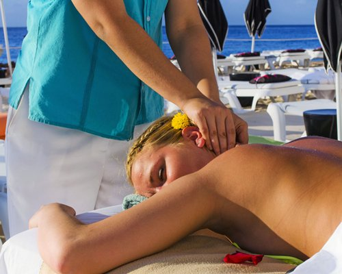 A woman having massage at the spa.