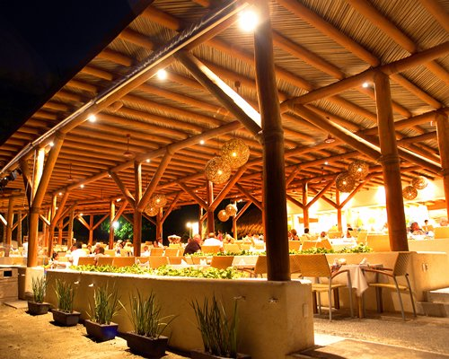 An exterior view of the outdoor restaurant at Pacifica Sands resort.