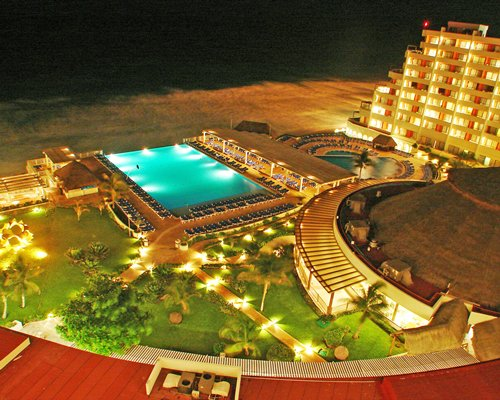 An aerial view of Golden Shores & Crown Paradise Club with outdoor swimming pool alongside.