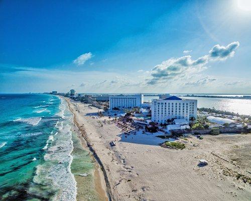 An aerial view of Sunset Royal Beach Resort alongside the ocean.