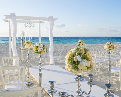 Outdoor decorated venue alongside the beach.