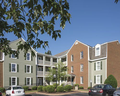 An exterior view of multi story resort units and parking lot.