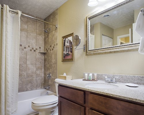 A bathroom with a bathtub shower open sink vanity and mirror.