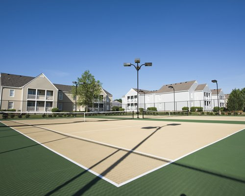Outdoor recreation area with a tennis court.