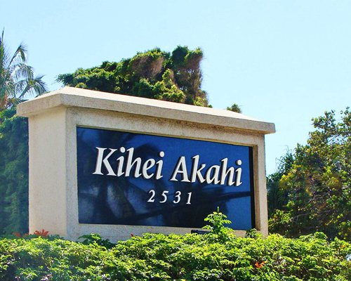 A view of the Kihei Akahi signboard alongside landscaping.