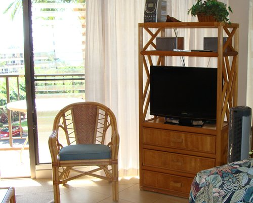 A well furnished living room with a television and patio.