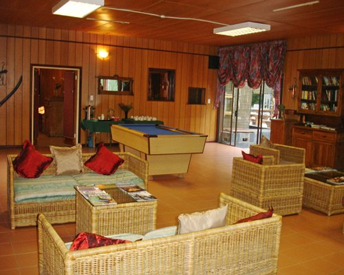 Indoor lounge are recreation room with pool table.