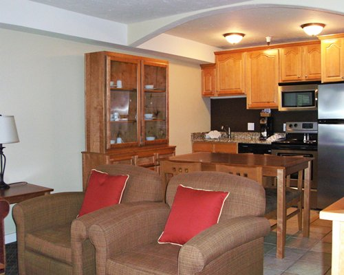 A well furnished living room with a dining area and open plan kitchen.