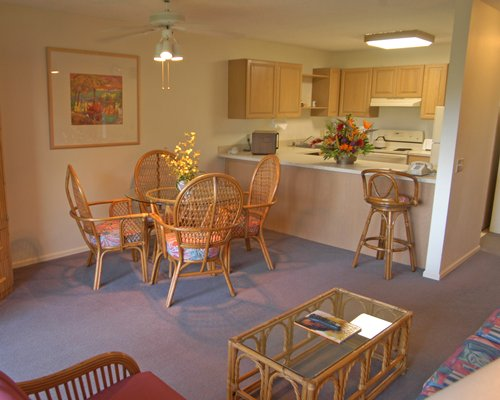 An open plan living and dining area alongside a kitchen.