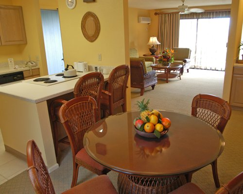 An open plan dining and kitchen area alongside the living room.