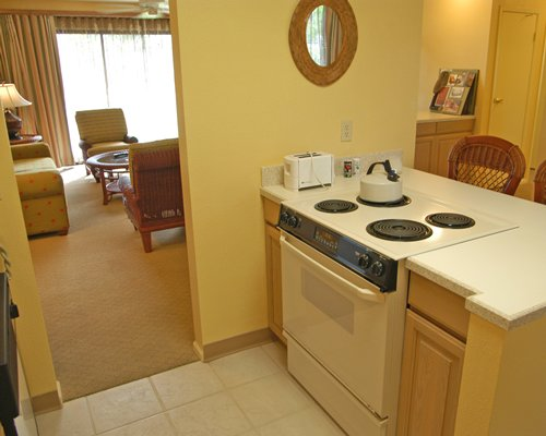 A well equipped kitchen alongside living area.