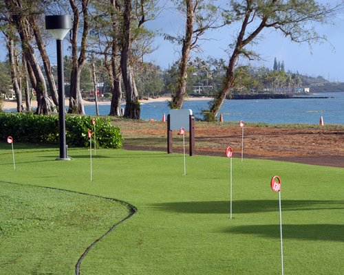 Scenic outdoor recreation area with lawn games alongside the beach.