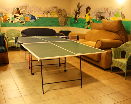 Recreation room with lounge area and a ping pong.