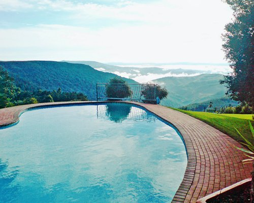 Scenic outdoor swimming pool surrounded by hills.