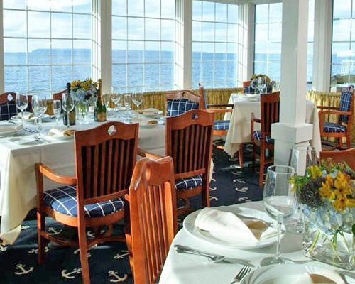 An indoor fine dining restaurant with a lake view.