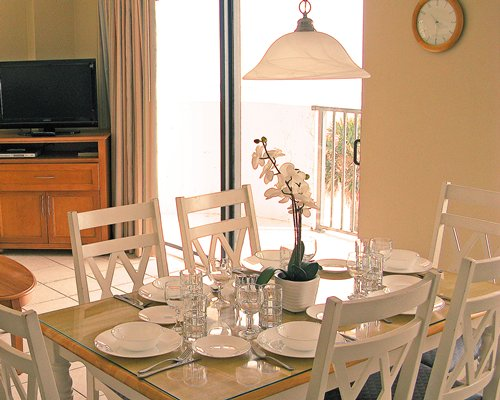 A well furnished dining area with television and an outside view.