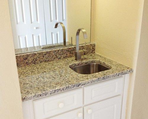 An open sink vanity.